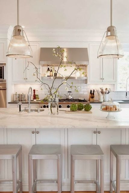 White cabinets (love the storage under the island), white & gray granite, and white subway tile