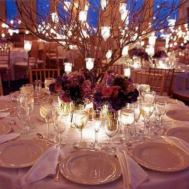 a pretty round table setting