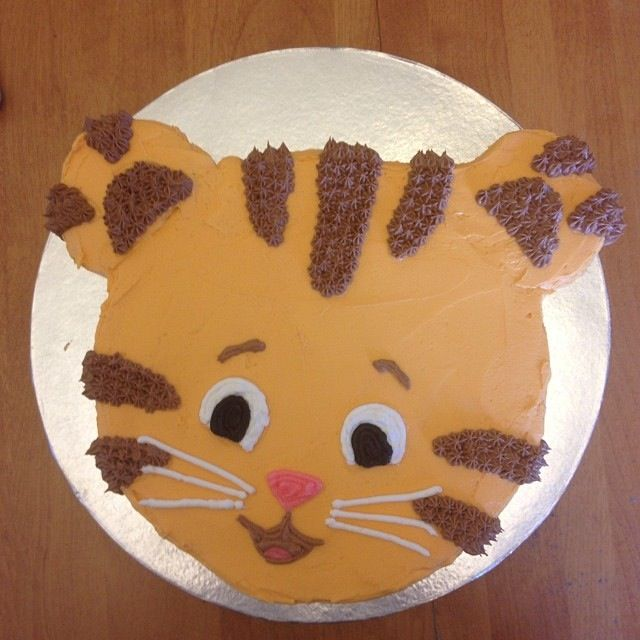 I made a Daniel Tiger cake for Maddie's 2nd Birthday. I traced a Daniel Tiger mask printed from the PBS website. The inside was marble chocolate and vanilla (tinted orange).