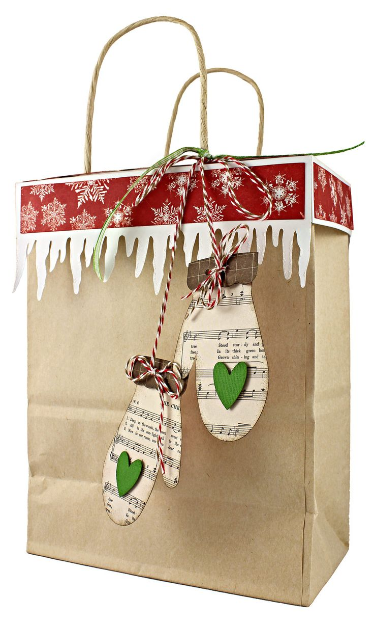 Gift bags don't have to be the wrapping of last resort! Class your bagged presents up with this project from our 12 Gifts of Christmas series. Day 3: Kraft Gift Bag Topper with Mittens