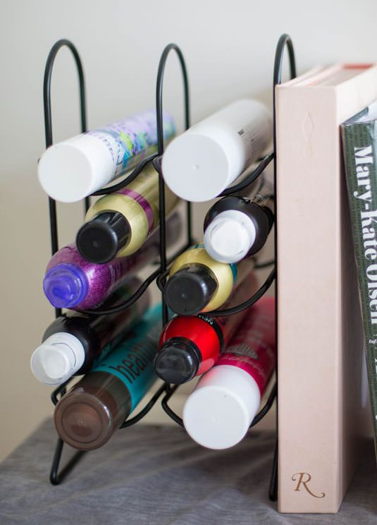 diy-Use a cheap wine rack to store all those hair products in the bathroom that are too tall for drawers, and just fall over and make clutter under the sink.