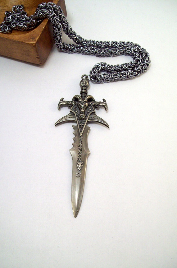 This awesome necklace features a pendant of the Lich King sword, Frostmourne, from the World of Warcraft game. The sword is massive at just over 4 inches long and has incredible detail.  The necklace is woven in byzantine using 18g black ice anodized aluminum.