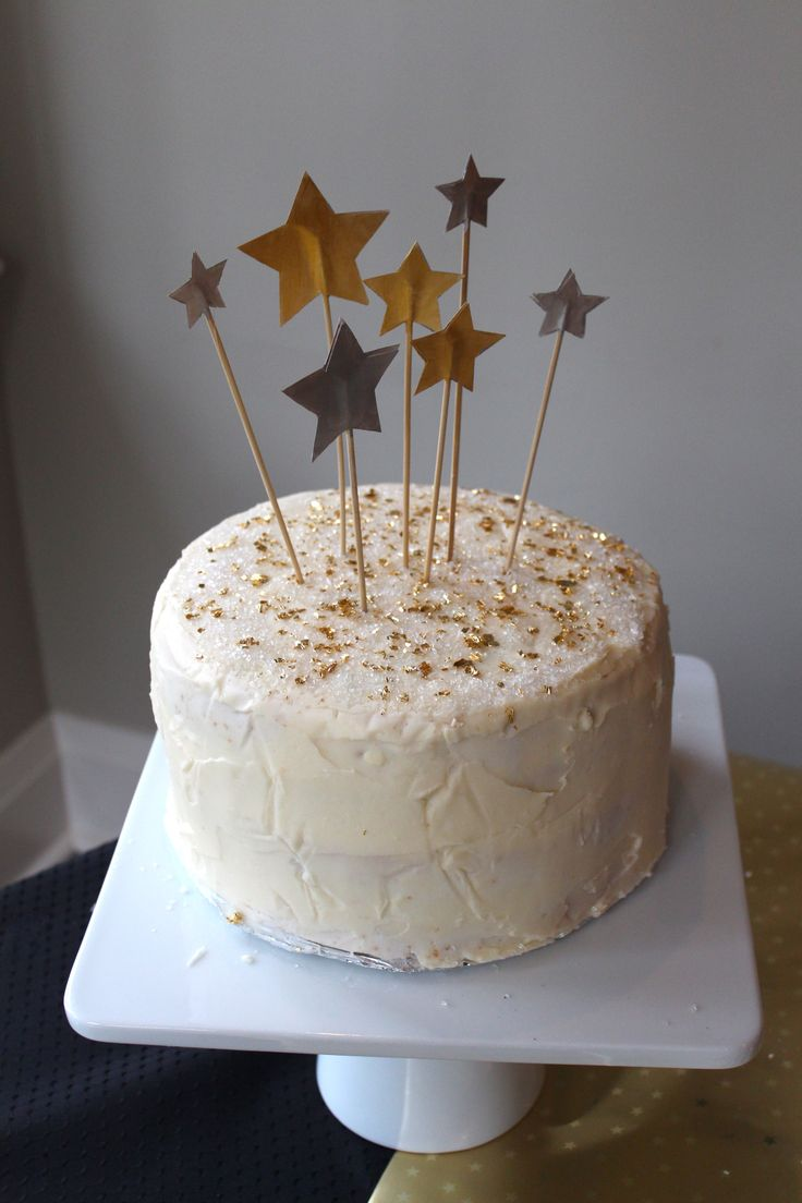 Starry Night themed birthday party // 1st birthday // DIY cake topper stars // 4 layer vanilla cake with buttercream icing