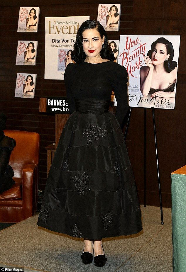 Signature style: Dita flaunted her figure in the full satin skirt which featured pretty floral embroidery and a sashed waist