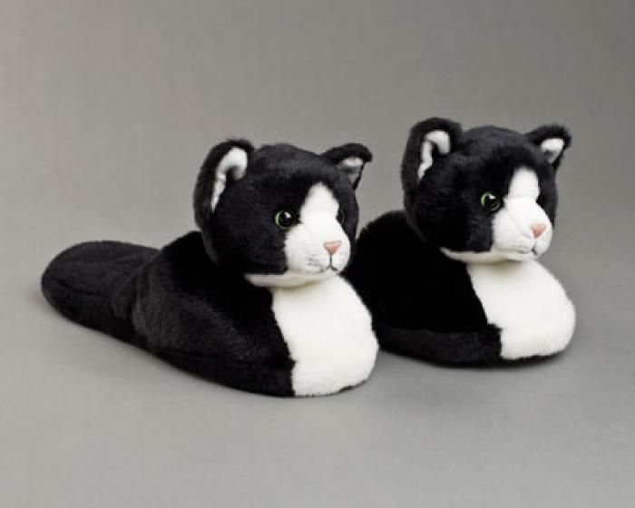 Kicking it off with a dose of classic kitty charm, a pair of black & white cat slippers is bound to bring a smile to cat folks everywhere. Description from bunnyslippers.com. I searched for this on bing.com/images