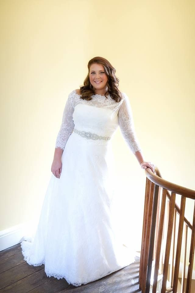 Beautiful A-line lace gown with removable 3/4 sleeve jacket (buttons in back with dress and fits snug, so it looks like all one piece). I purchase...