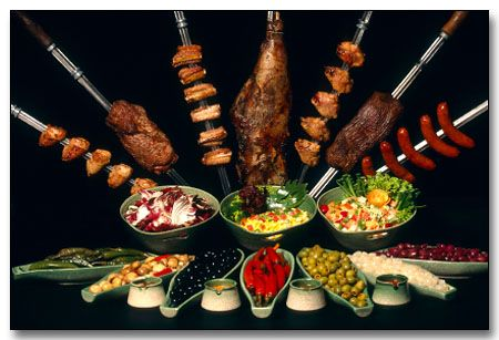 At a Brazilian churrasco, the servers come around slicing 20 or more different meats from skewers onto your plate.