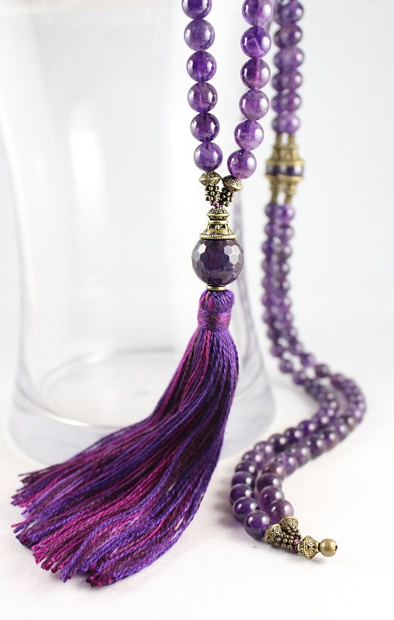 A lovely strand of natural medium purple Amethyst beads (or Purpleheart wood beads) with choice of hand made tassel colour (pictured with mixed purple) and antique brass findings. Please choose tassel colour in drop down menu.  There are 108 8mm beads in the strand. Amethyst is one of the best gemstones for calming the mind and is perfect for any meditation practice. In Tibet, amethyst is considered sacred to Buddha, possibly due to its ability to activate and balance the 6th chakra (third…