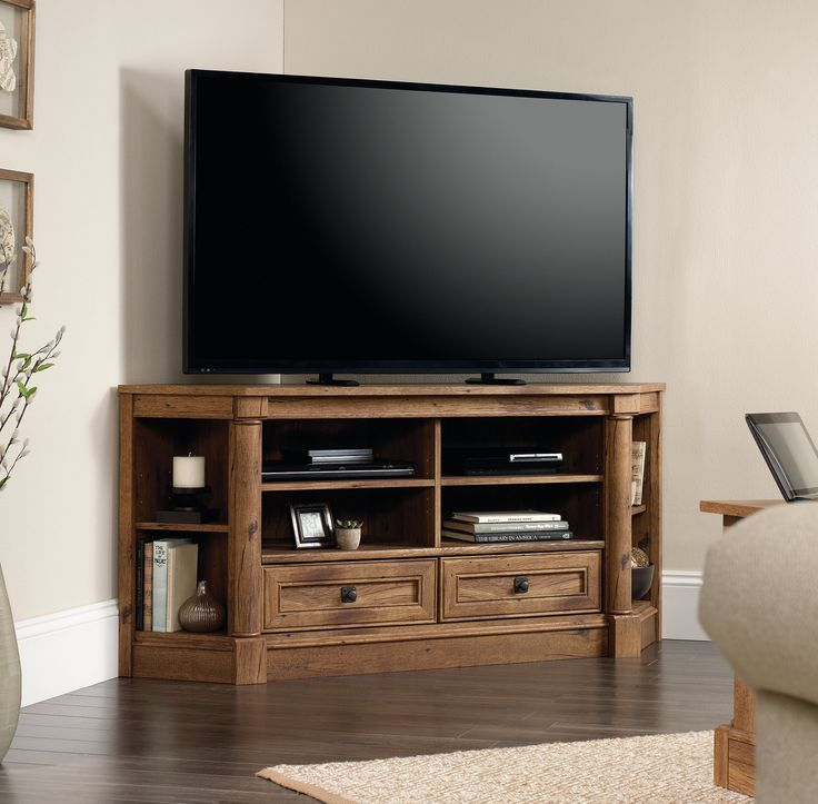 "Features:  -Accommodates up to a 60"" TV weighing 95 lbs. or less.  -Two adjustable shelves hold audio/video equipment.  -Two adjustable corner display shelves.  Country of Manufacture: -United States."