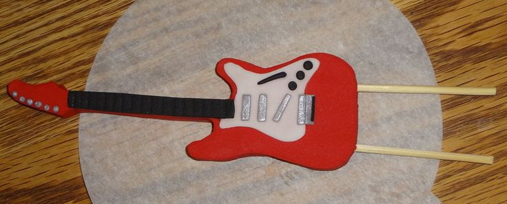 Fondant guitar i used the guitar templates from for Guitar templates for cakes