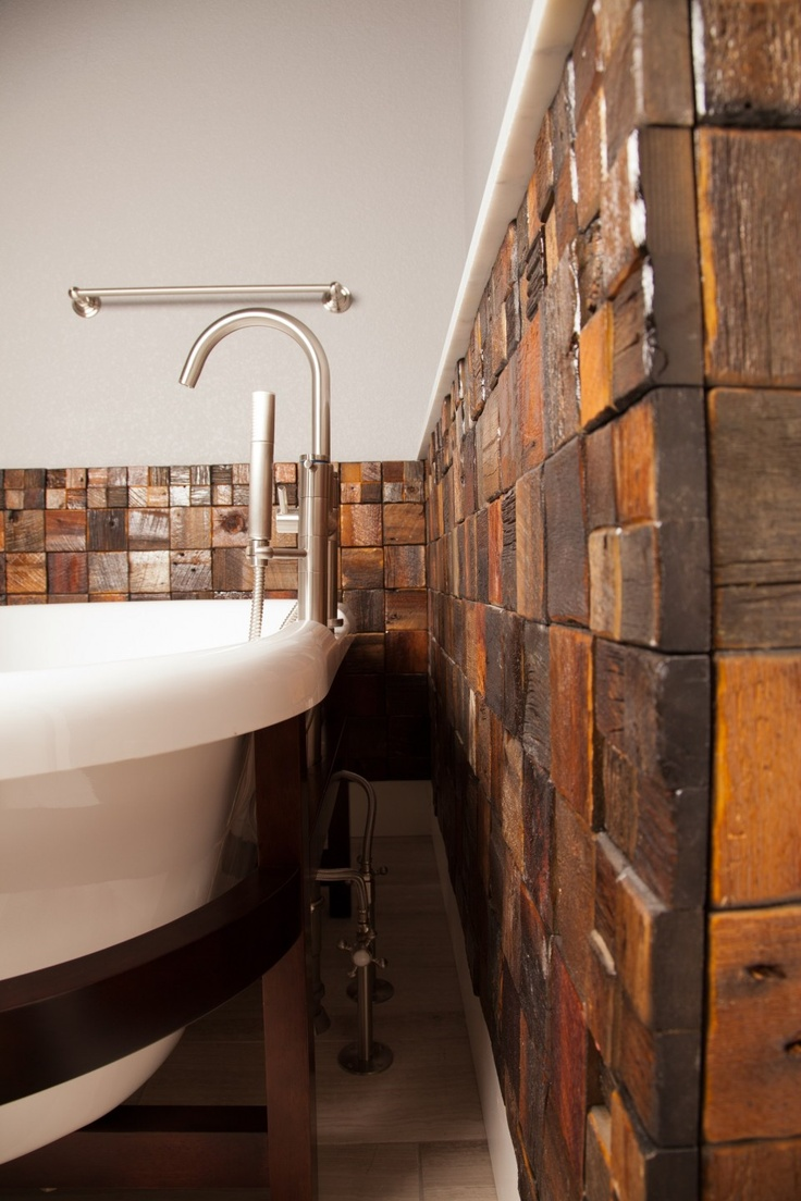 reclaimed barnwood used as a backsplash for a free standing tub