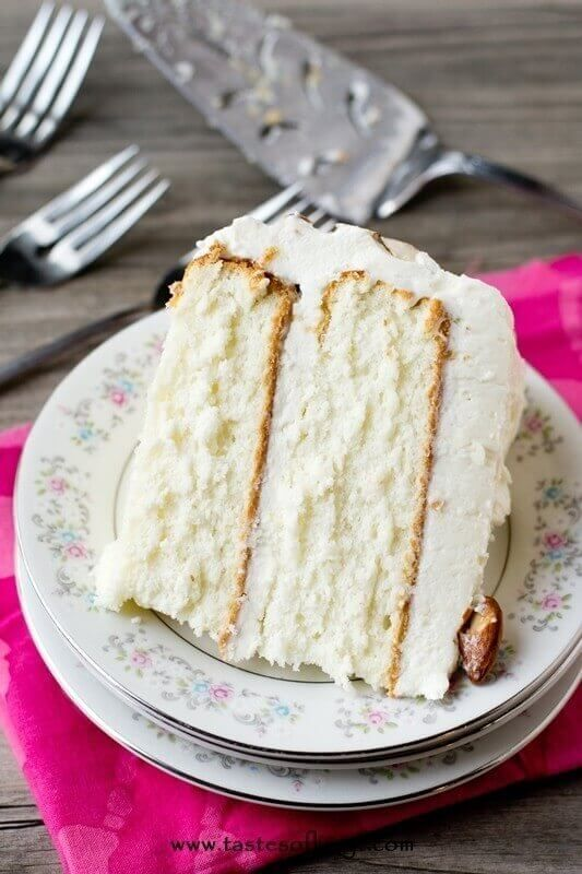 Light, moist and velvety, this Almond Cream Cake has a homemade cooked, whipped frosting that pairs perfectly with the almond cake. Top with sliced almonds.| tasteoflizzy #Cake #Almond