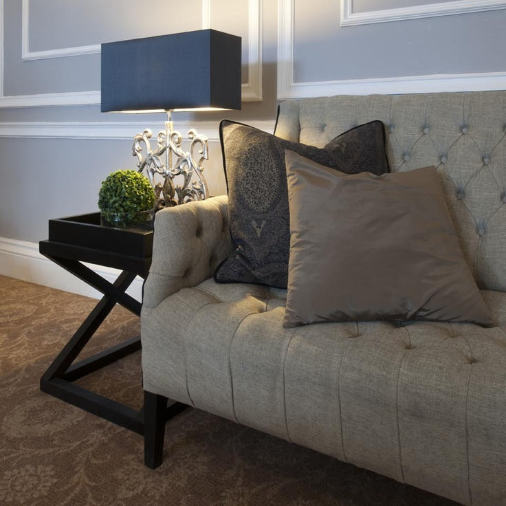 The Roxburghe Hotel, Edinburgh. A listed Georgian Building with a stylish grey interior by Glasgow based Interior Designers, Occa Design. Button back sofa, cushions, feature lamps, classic, elegant