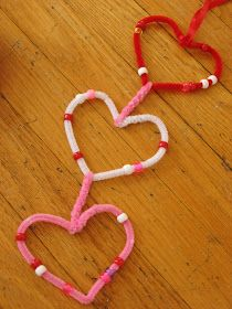We've been making a variety of Valentine garlands here. Some the kids have been able to help with, like this one, and some I've made myself...