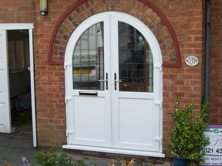 Stunning arched French door. http://www.finesse-windows.co.uk/french_doors.php