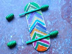 Make your own Skateboard: Popsicle Stick, Toothpicks, Markers, Beads for wheels and a few dots of craft glue or hot glue.