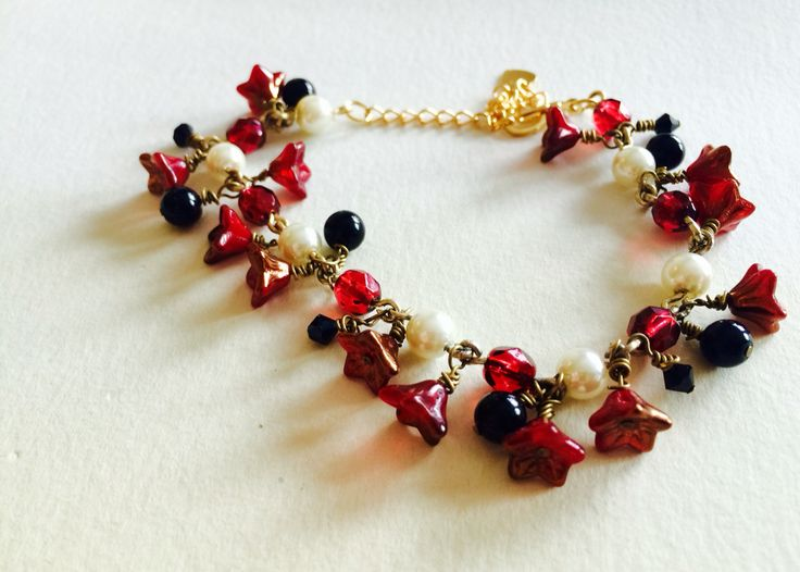 Czech glass beads, Swarovski crystal and glass pearls beaded charm bracelet made by me for Ariadne's Creations.
