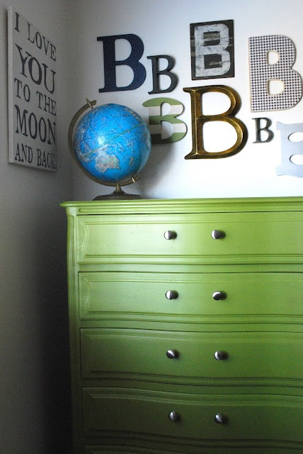Like the green dresser & the different types of letters as wall decor.