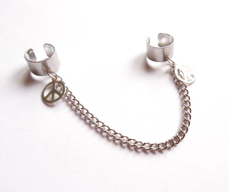 Dubbel ear cuff i silverplätering med kedja och peacetecken.