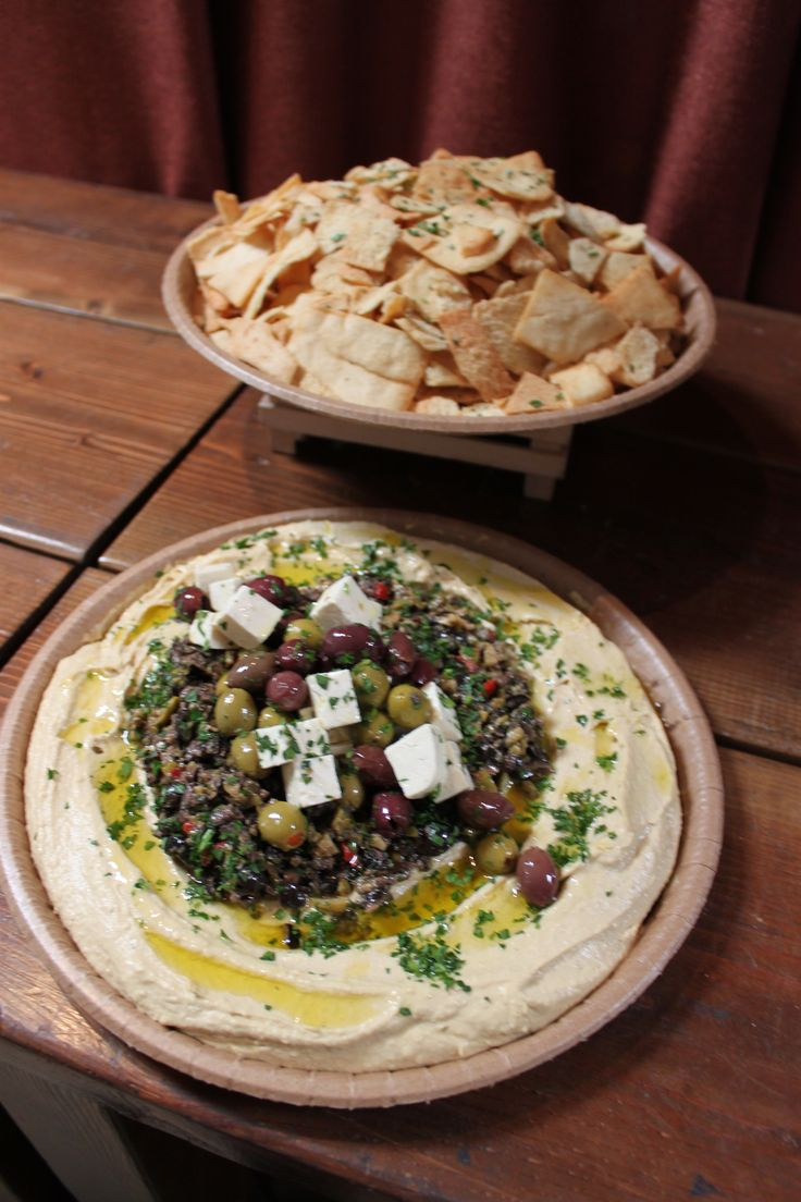 MEDITERRANEAN MEZE PLATTER Creamy Hummus and Olive Tapenade Drizzled with Extra Virgin Olive Oil, Feta, Olives and Fresh Herbs - Served with homemade Pita Chips