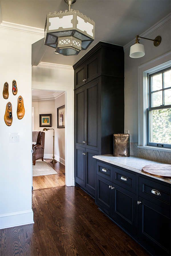 A Dark Blue Kitchen With Dark Wood Flooring Wood Floor Kitchen Dark Blue Kitchens Grey Wood Floors Kitchen