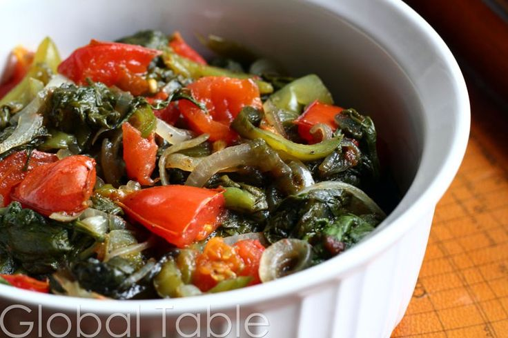 Serves 2-4 I love this easy, no-nonsense, super healthy side dish from Botswana. Simply steam spinach in its own juices until all the vegetables are soft. If you'd like to leave the tomatoes a lit...