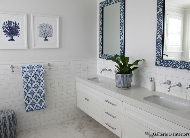 Classic Hamptons style blue and white bathroom with bone inlay mirrors. Gallerie B Interiors.