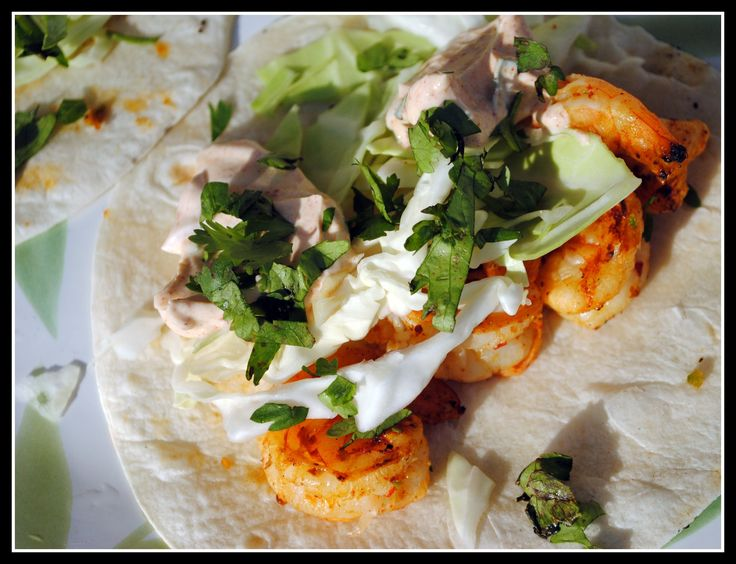 Citrus shrimp taco with a southwestern taco cream sauce. I would also ...