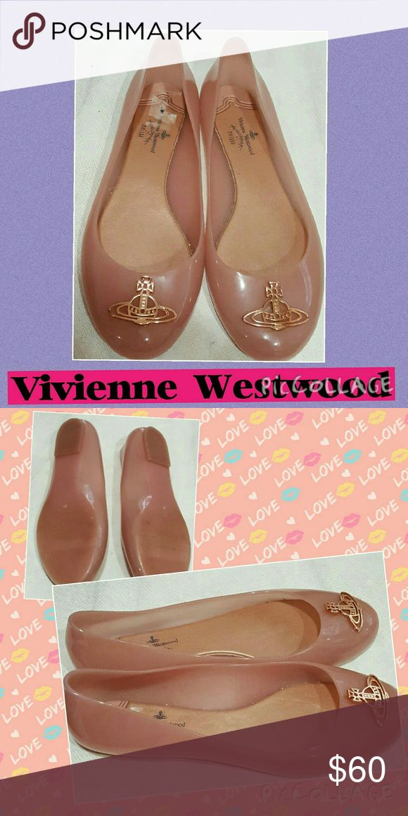 Vivienne Westwood Melissa Rare Orb Ballet Shoes 9 Vivienne Westwood with Melissa (plastics). Size US 9. Good condition.  One Orb trim is missing the backing to one bolt.  Very minor as still very solidly bolted down. Hard to find.  A little price sticker residue on insole. They are amazing! !!!!!! Vivienne Westwood Shoes Flats & Loafers