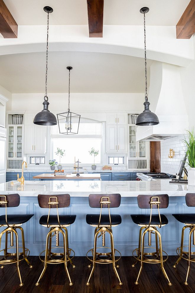 Blue and white kitchen. White upper cabinet paint color is Benjamin Moore Swiss Coffee. Lower blue cabinet paint color is Benjamin Moore Van Courtland Blue #BenjaminMooreSwissCoffee #BenjaminMooreVanCourtlandBlue Becki Owens Becki Owens & Jamie Bellessa
