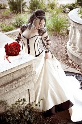 Goth Girl going white with black accents, tastefully in her  wedding gown in the funeral. Perfect setting.