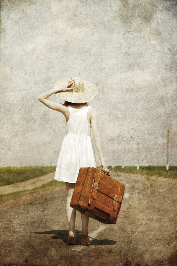 Lonely Girl with Suitcase at Country Road; photograph by Vladimir Nikulin