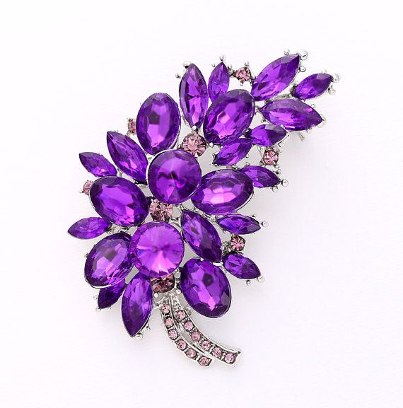 Gorgeous rhinestone purple brooch jewelry, which can be used for your DIY project - purple wedding bridal broach bouquet, gown sash, ring pillow, cake decorations, event decor, crafts, scrap booking and much more! Size: 2 3/4 inch high 2 inches wide Stone color: Violet purple, amethyst