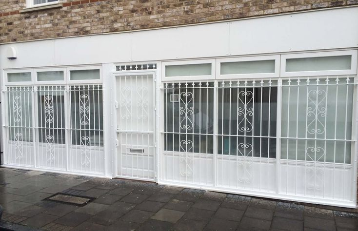 RSG3000 security gate with RSG2000 bar grilles fitted respectively to the door and windows of commercial offices in Camberwell, London.