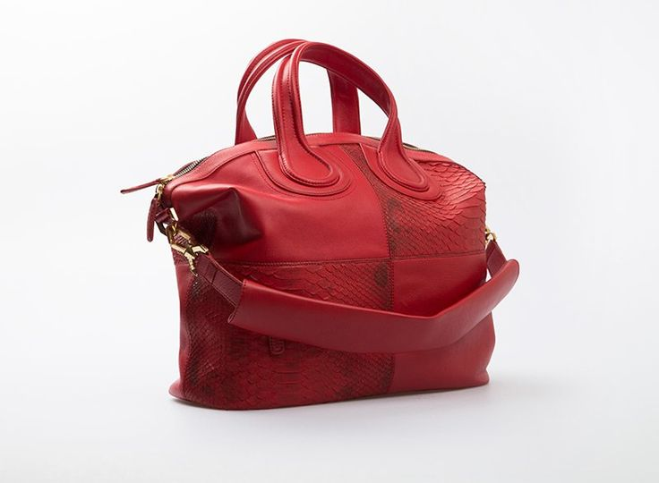 Gevency Bag by Cupio. A pretty hand bag crafted from genuine phytons leather in red color. Features with sling strap and has a little pocket inside the bag.  http://www.zocko.com/z/JJr7q