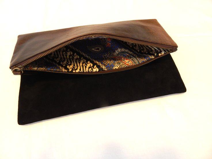 NV Reversible Leather Clutch, Batik lined, $80