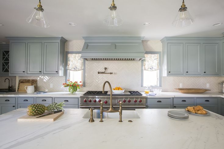 Pale blue kitchen cabinets marble countertops