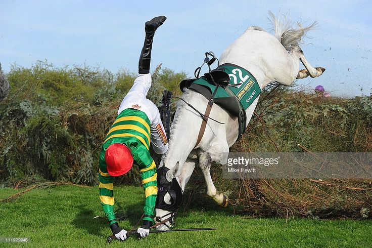 M. P. Walsh parts company with Quolibet at the 11th fence during the John Smith's Grand National Steeple Chase at Aintree Racecourse on April 9, 2011 in Liverpool, England.