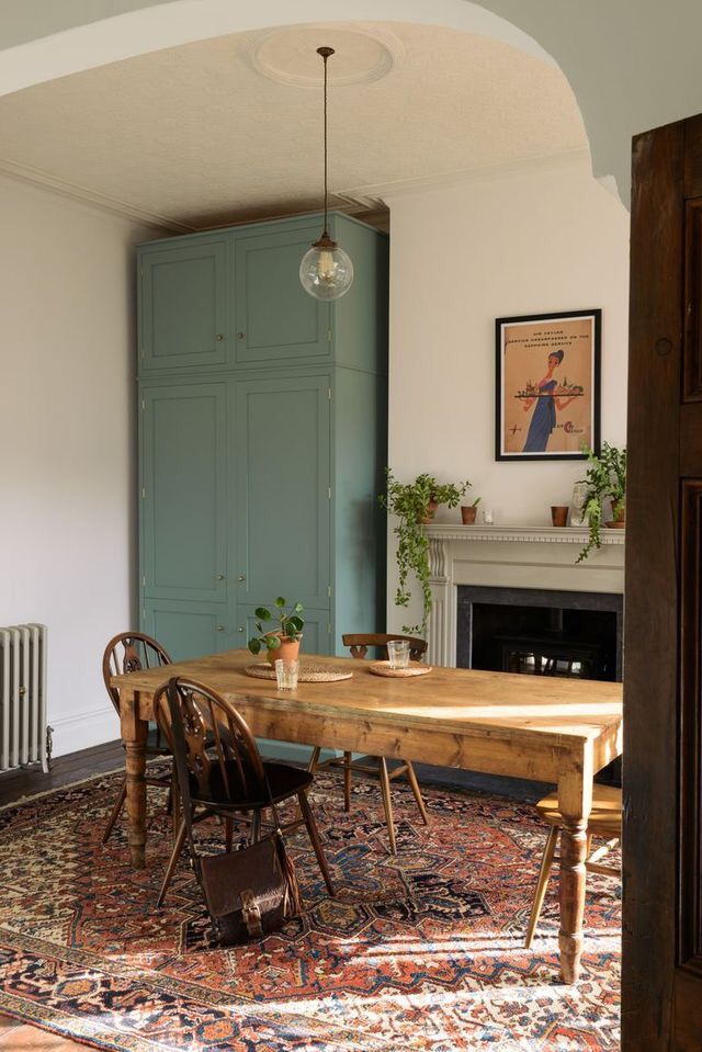 Farm table. Antique rug. Sage accents.