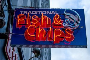 Image of a neon fish & chips sign in London Top 5 Fish and Chips Spots in London