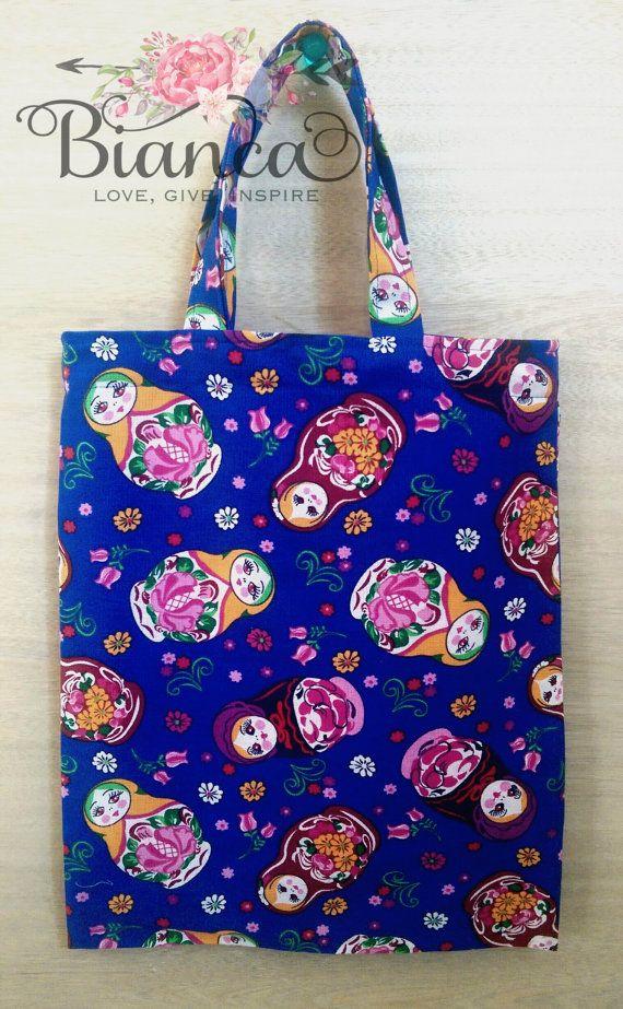 Babushka library bag  https://www.etsy.com/au/listing/248152784/library-bag-book-bag-babushka-doll