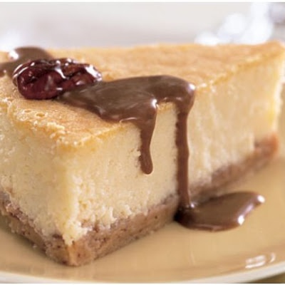 Mascarpone Cheesecake with Candied Pecans and Dulce de Leche Sauce