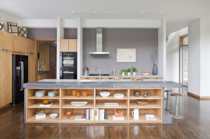 Wood and concrete Kitchen, large bench, gas oven, large kitchen, pantry cupboard, kitchen cupboards flow to ceiling, 3 walls, wide window sill over basin
