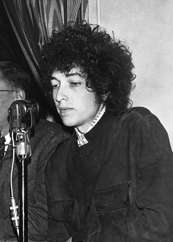 "Bob's Mysterious Magical Motorcycle Accident (haiku) ""Blinded by the light - or revved up like a douche, a - runner in the night?"" Bob Dylan gestures during a May 1966 press conference in Paris. (AP Photo/Pierre Godot, file)"
