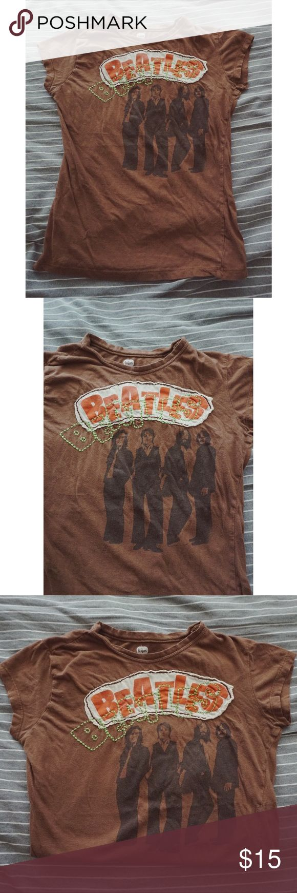 Brown Beatles Tee Rad Beatles tee featuring unique embroidery detail. Originally purchased at the Cirque du Soleil show LOVE in Las Vegas many years ago. This tee has gotten a lot of use and has fading and pilling throughout. I personally think it gives this piece a neat vintage look. Soft material. Size large but runs a bit small (fits more like a small/medium). Feel free to ask any further questions or make an offer via the offer button👇 Apple Corps Tops Tees - Long Sleeve