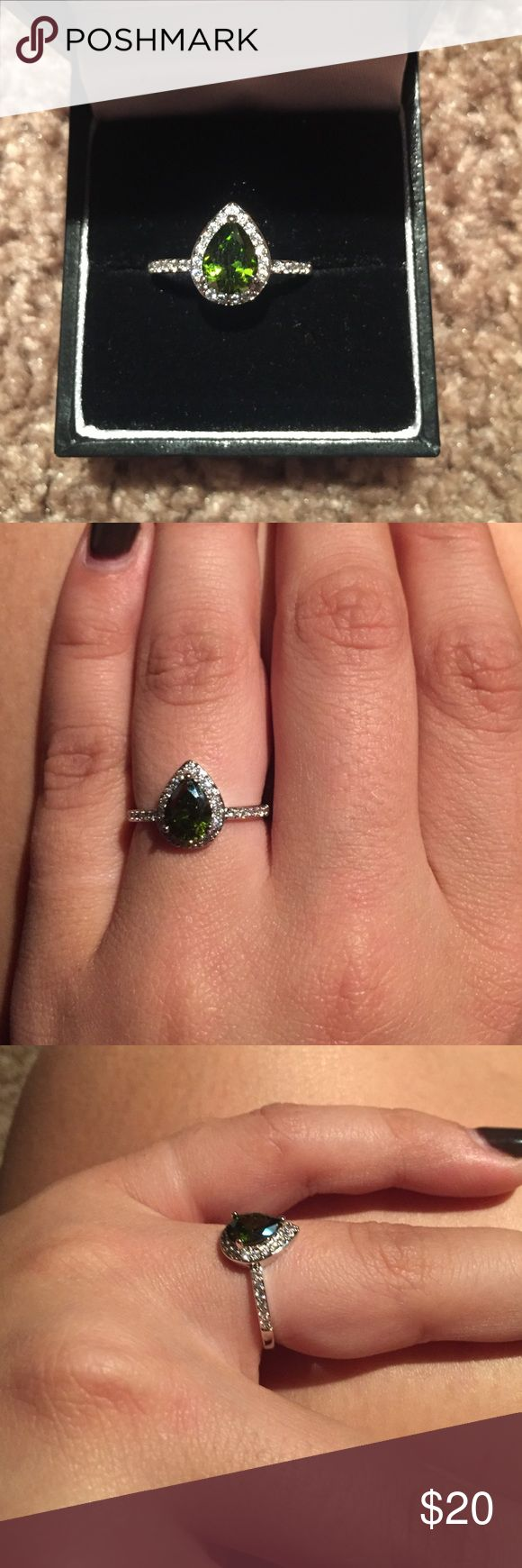 Green Teardrop Diamond Ring This is a green teardrop Diamond ring with a halo around the main stone and gems down the sides of the ring. It is a size 7. The band is made out of rhodium. It has never been worn and is still in perfect condition! Jewelry Rings