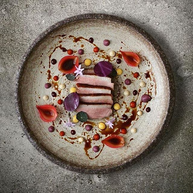Duck, onion petals, lemon, red cabbage, mayo, chili jam, wild raspberry jam & duck sauce. Dish uploaded by @alvinssto #gastroart