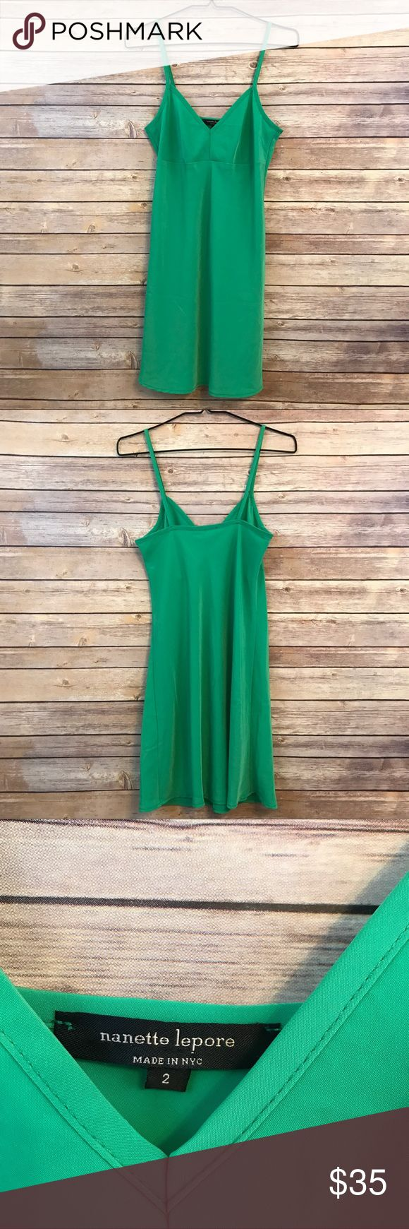 """Nanette Lepore green cami slip dress size 2, 207 This pretty green cami dress by Nanette Lepore is perfect for summer, it's a mini dress. It is marked a size 2 US and measures 16.5"""" flat across the bust 15.5"""" flat across the waist and is 33"""" long. In good overall condition, straps have been sewn up slightly to shorten, could be removed with cutting the stitching. No other flaws seen, light overall wear. See all images. Nanette Lepore Dresses Mini"""
