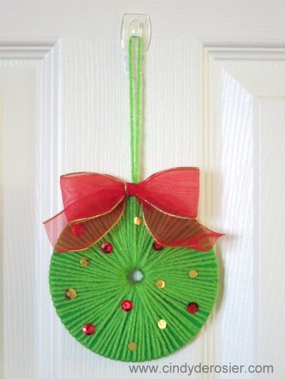 Use yarn to turn an old CD into a beautiful Christmas wreath. It's fast, easy, and fun!