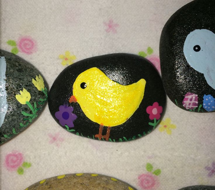 Cute little chick painted rock used a top coat of yellow glitter paint on the chick to add some sparkle